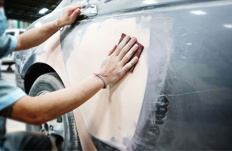 Image of a person cleaning the exterior of a car
