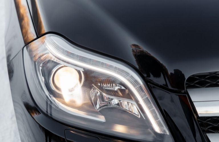 Image of a headlight of a black car