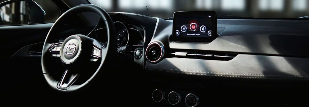 How to configure the gauge display in Mazda vehicles