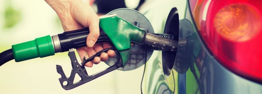 person-filling-up-vehicle-with-green-gas-pump