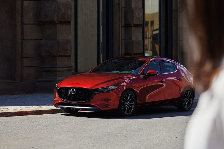 Red 2020 Mazda3 Hatchback from driver side_o