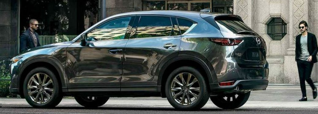 2019 Mazda CX5 driver side people near front and rear