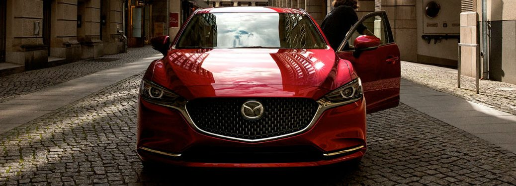 2020 Mazda6 red exterior front fascia woman exiting driver side door