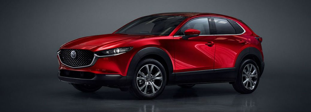 2020 Mazda CX-30 red exterior driver side front fascia grey background