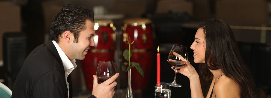 couple drinking red wine at a fancy restaurant
