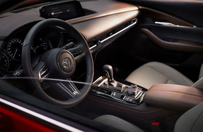 2020-Mazda-CX-30-drive-side-view-of-interior-steering-wheel-and-dashboard-area_o