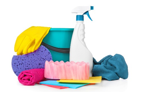 pile of cleaning supplies white background