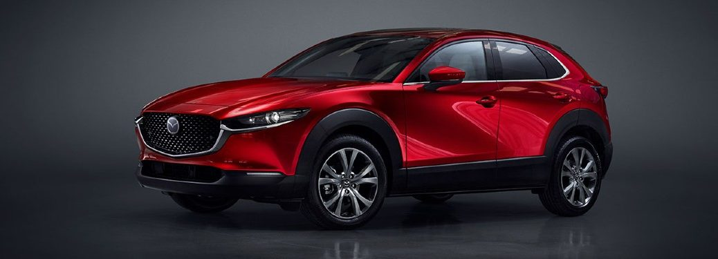 2020 Mazda CX-30 red exterior front driver side parked inside of grey room