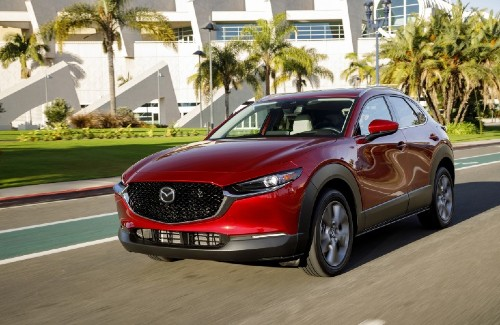 2020 Mazda CX-30 red exterior front driver side driving on street