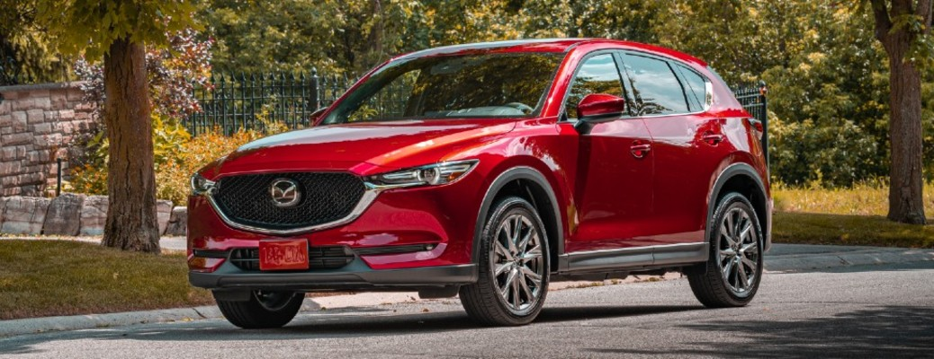 2020 Mazda CX-5 Signature red exterior front driver side driving in city
