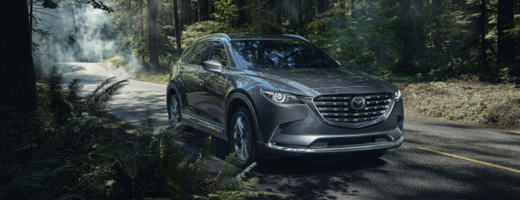 2021 Mazda CX-9 grey exterior front fascia driving on forest road