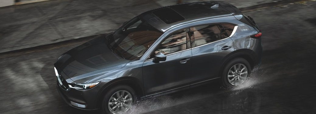 top view of 2021 Mazda CX-5 driving in the city through puddles