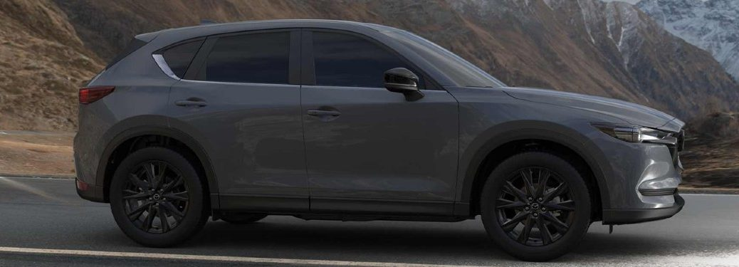 2021 Mazda CX-5 Carbon Edition passenger side facing driving on highway