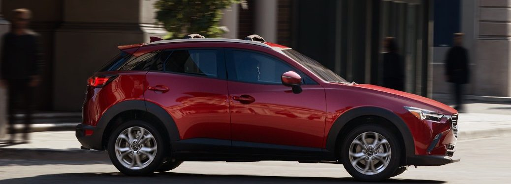 2021 Mazda CX-3 red exterior passenger side driving in city