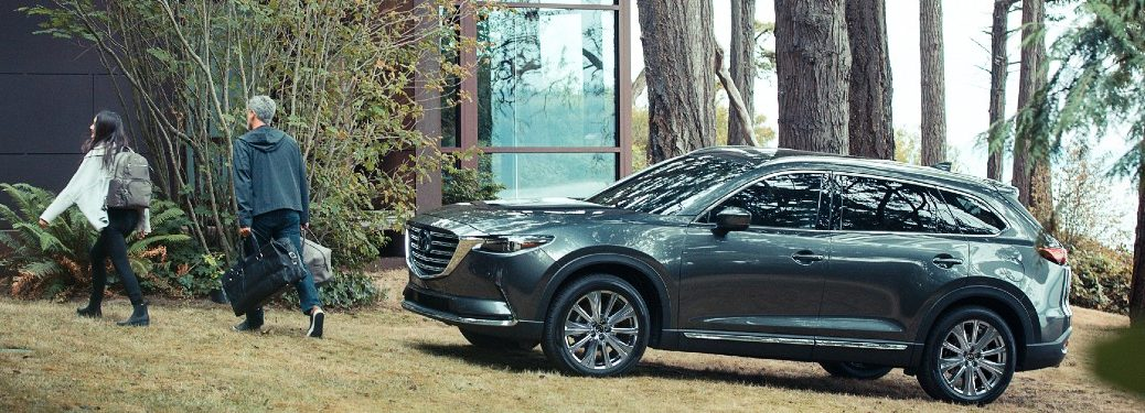 2021 Mazda CX-9 driver side parked in yard of lakeside house