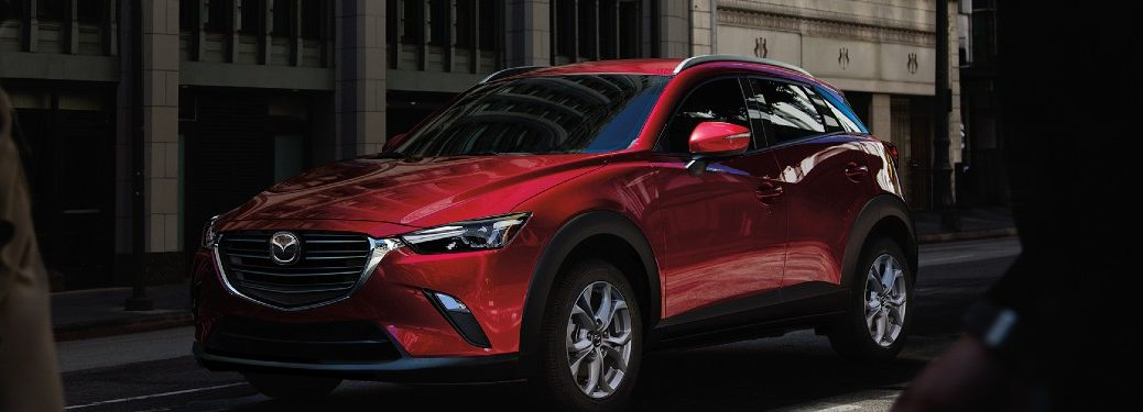 2021 Mazda CX-3 red exterior front fascia driver side parked on side of street