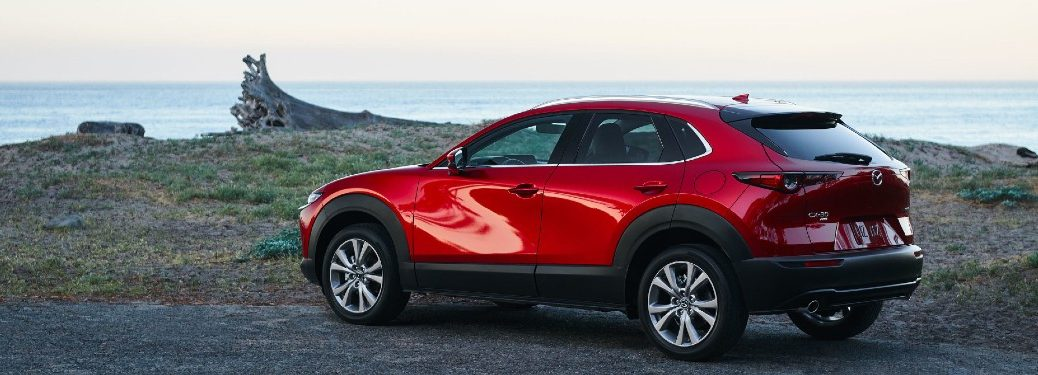 2021 Mazda CX-30 red exterior rear fascia driver side parked near lake front