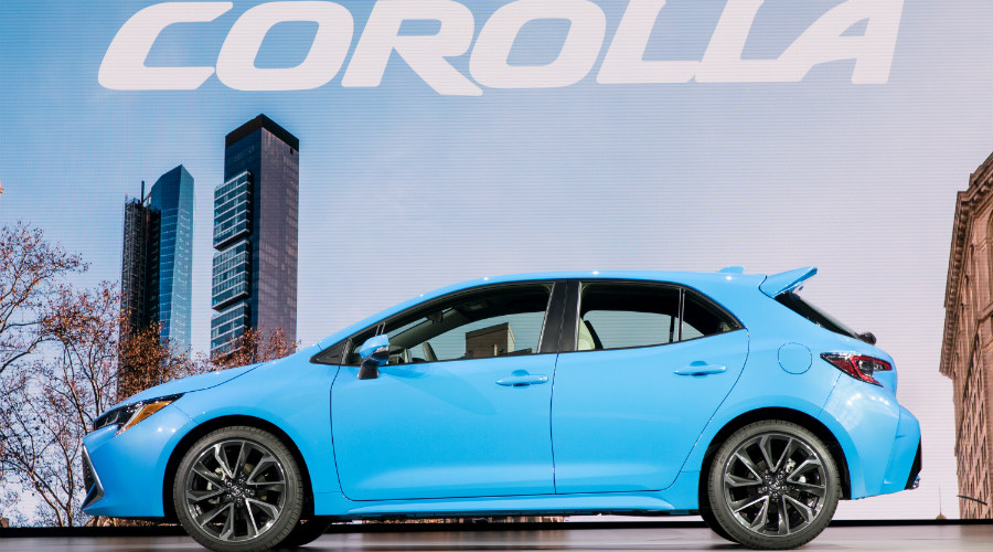 Side view of a blue 2018 Toyota Corolla Hatchback