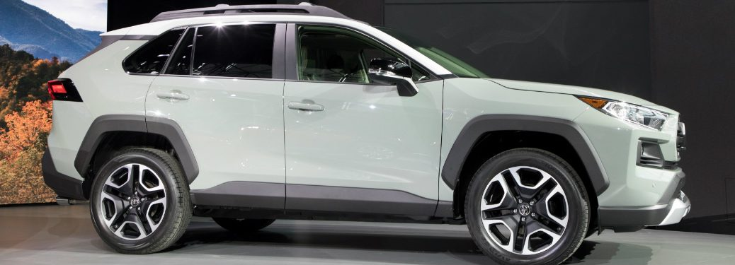 Side view of a white 2019 Toyota RAV4 at NYIAS