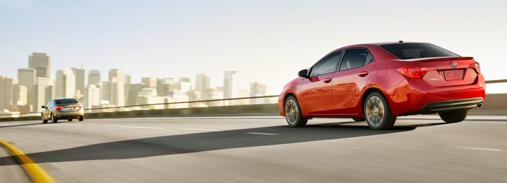 Red 2019 Toyota Corolla driving along the highway