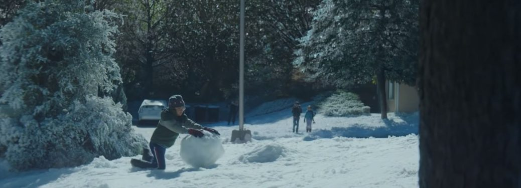 Kid building a snowman in Toyota Home for the Holidays commercial