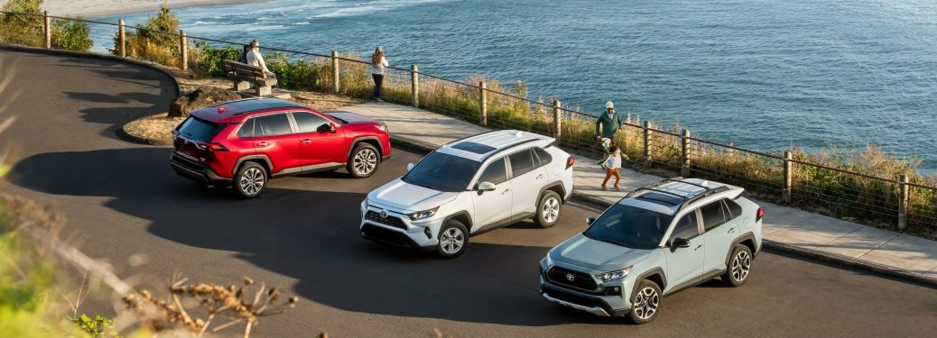 Three 2019 Toyota RAV4 models in a parking lot
