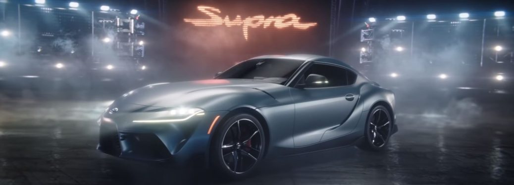 2020 Toyota Supra parked below Supra sign