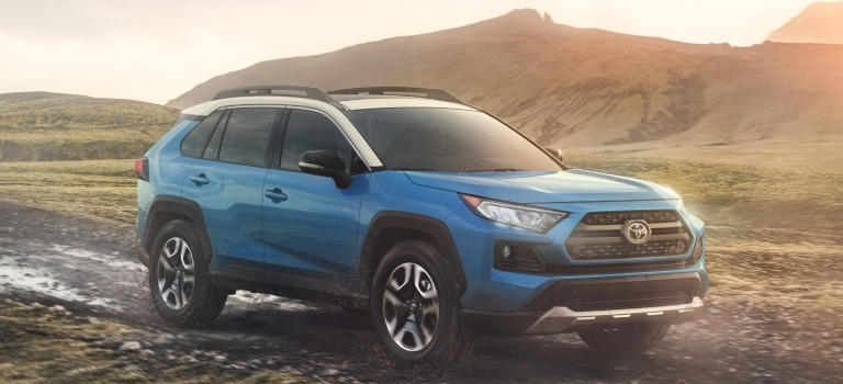 2019 Toytoa RAV4 blue and white side view