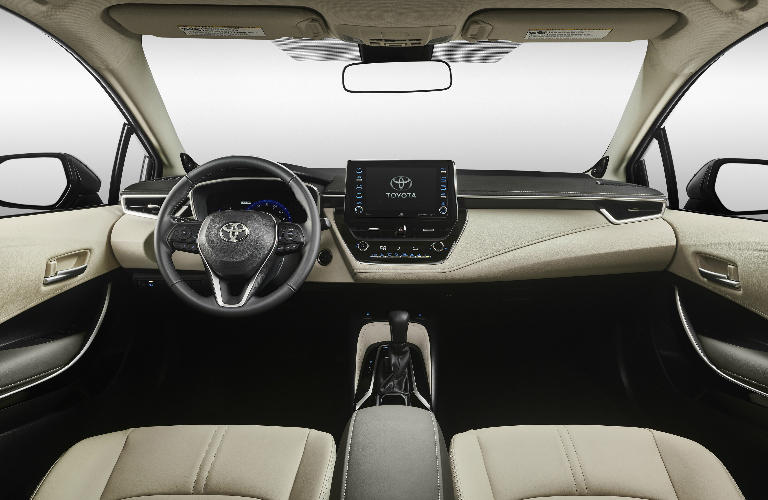 Dashboard and beige front seats in 2020 Toyota Corolla