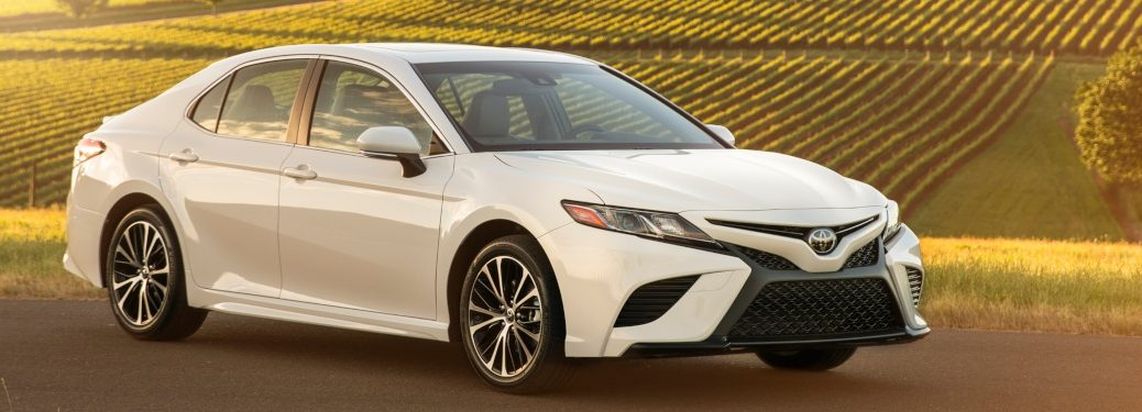 Side view of a white 2018 Toyota Camry