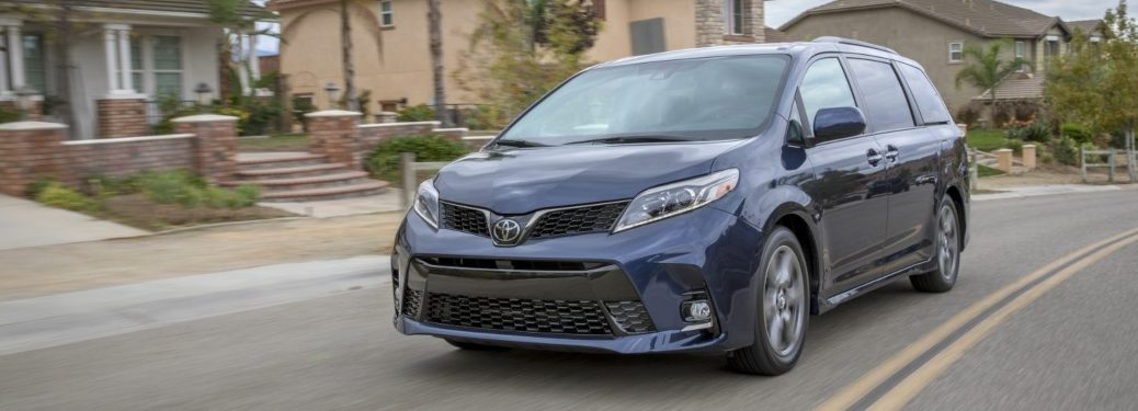 Blue 2019 Toyota Sienna driving on open road