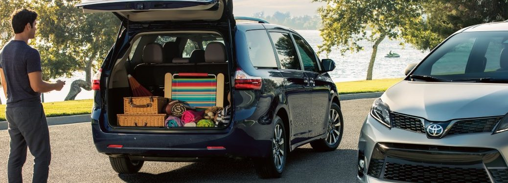 Man packing up a 2020 Toyota Sienna with luggage