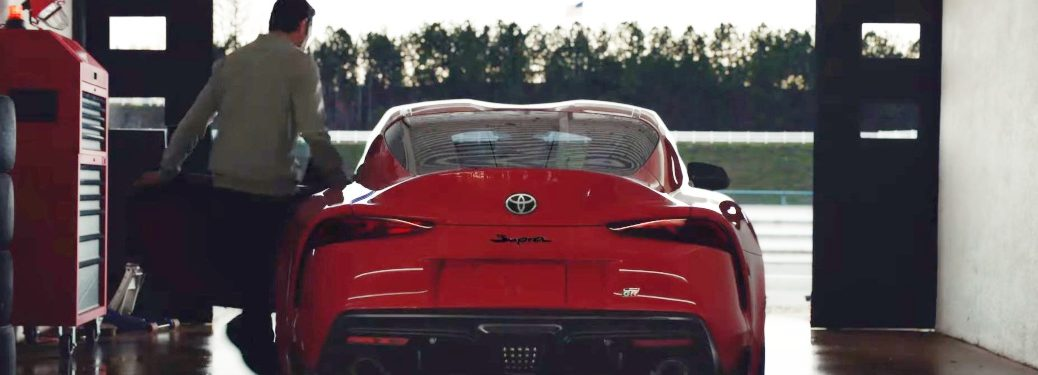 Man getting into the driver's seat in the 2020 Toyota Supra