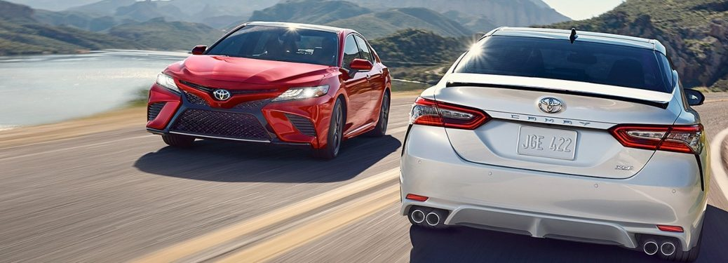 2019 Toyota Camry sedans going past each other on the road