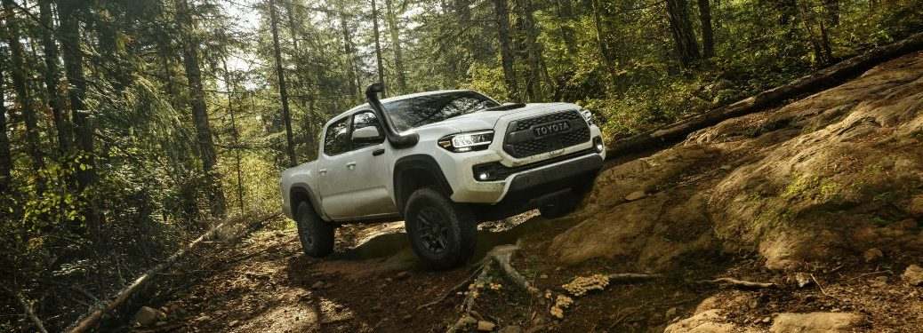 2020 Tacoma TRD Pro driving through wooded mountains