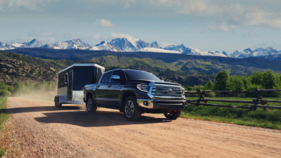 2020 Tundra pulling a livestock trailer on dirt road