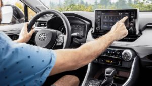 2020 RAV4 touchscreen being operated by driver