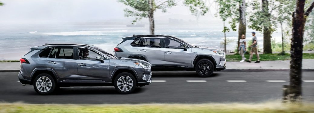 two 2020 RAV4 models driving on a scenic road