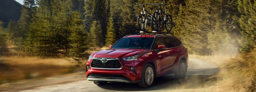2020 Highlander on a forest trail with bicycles on roof