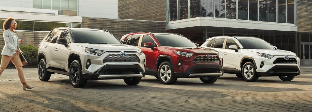 Three 2020 RAV4 Hybrid models lined up in front of house