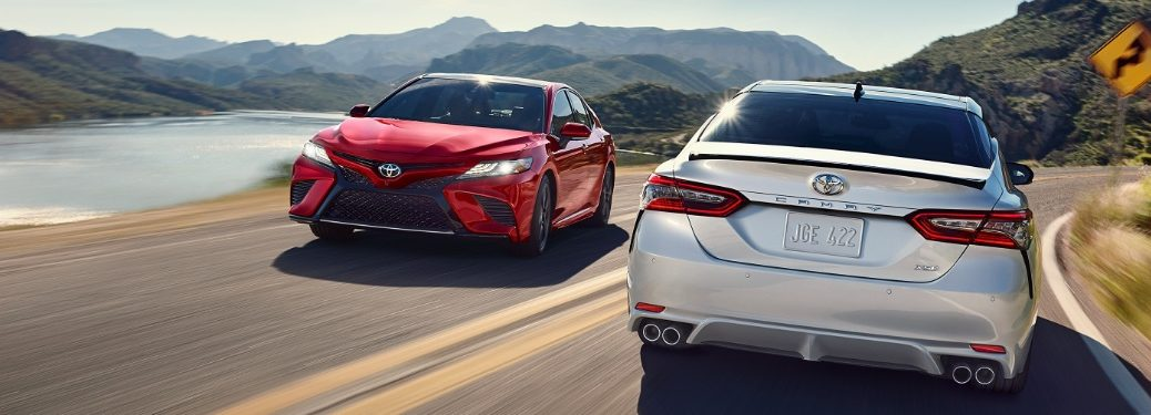 two 2020 Camry models driving past each other