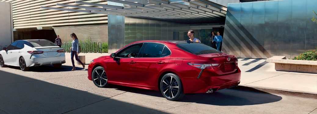 2020 Camry models parked outside of modern building
