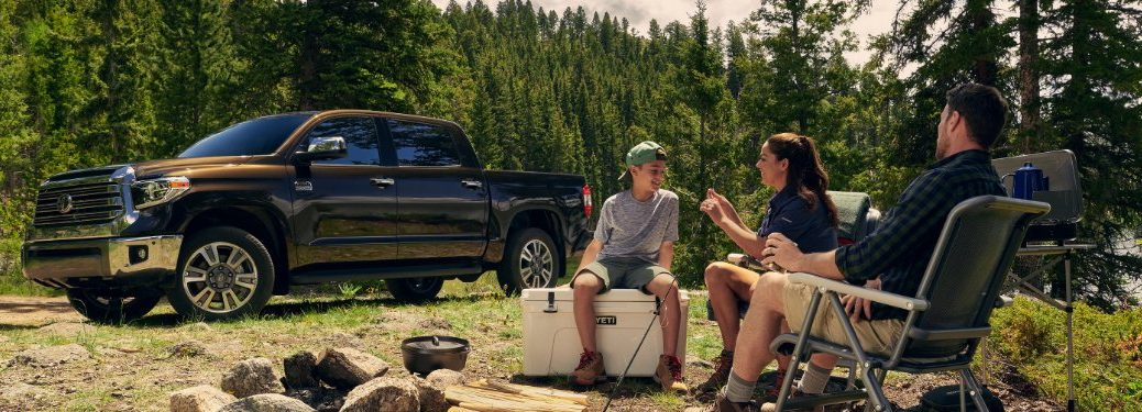 family at campsite next to a 2021 Tundra