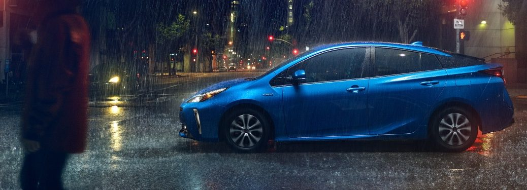 2021 Prius waiting at a rainy intersection