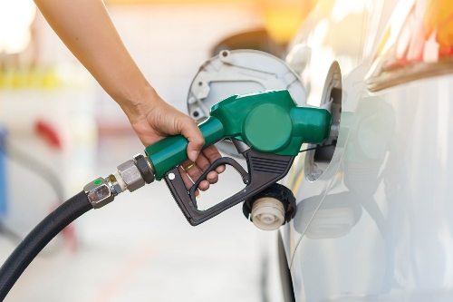 person putting gas in vehicle