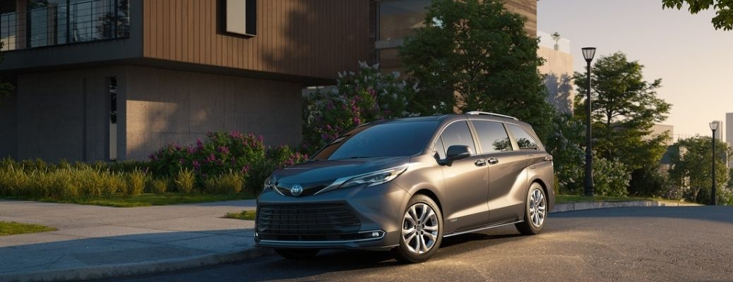 2021 Toyota Sienna parked in front of a house.