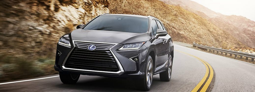 2019 Lexus RX 350 drives around a highway curve.