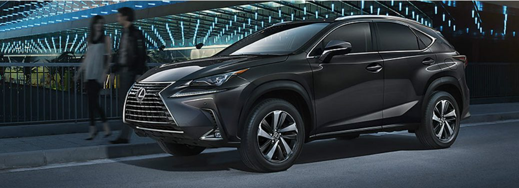 2019 Lexus NX parked outside a well-lit futuristic stadium.