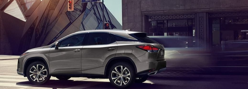 Silver 2020 Lexus RX Side Exterior on a City Street