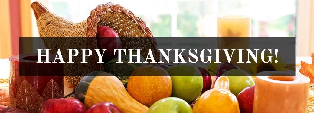 Thanksgiving Cornucopia with Fruits and Vegetables on a Table with Black Text Box and White Happy Thanksgiving! Text